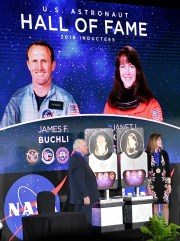 James F. Buchli and Janet L. Kavandi, members of the United States Hall of Fame, are presented to the crowd during Saturday's ceremonies at the Kennedy Space Center Visitor Center.