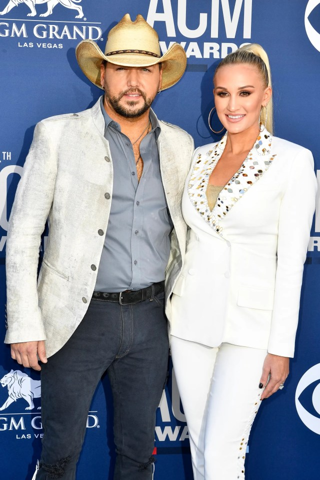 Jason Aldrean, left, with Brittany Kerr Aldean, walk the red carpet at the 54TH Academy of Country Music Awards Sunday, April 7, 2019, in Las Vegas, Nev.