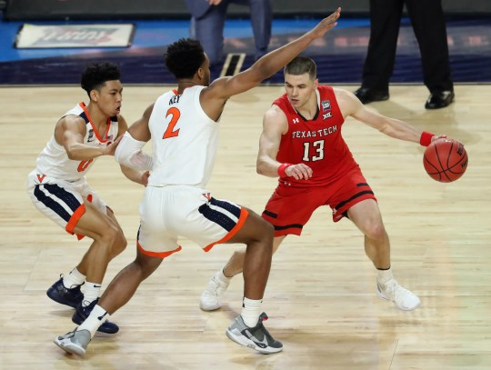 Texas Tech guard Matt Mooney (13) drives around Virginia defenders during the championship game of the 2019 NCAA tournament.