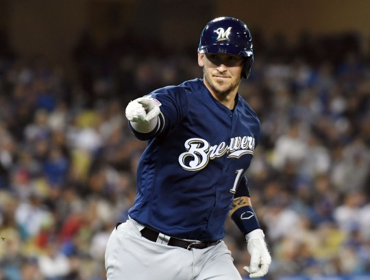 Brewers wide receiver Yasmani Grandal rounds the bases after hitting a two-run homer against the Dodgers during the fifth inning.