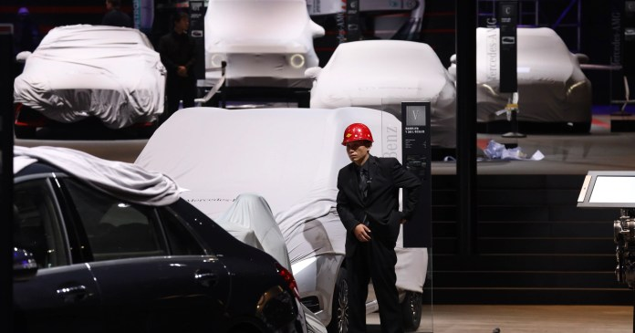 electric car makers woo chinese buyers with range, features at