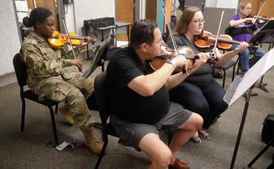 Jordan Marie Robinson, a Florida & AM student in ROTC, plays the violin during Big Bend Orchestra practice on Thursday 11 April 2019.