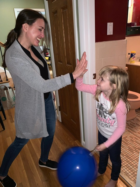 Samantha Allen, founder of NYC Potty Training, helps a young client learn to use the toilet.