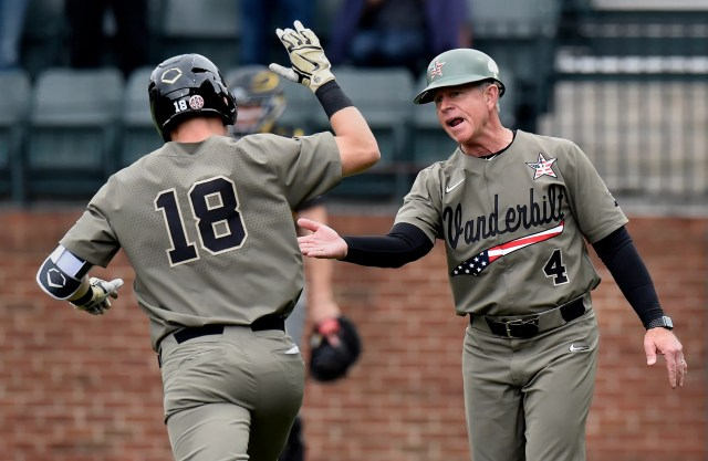 Vanderbilt center fielder Pat DeMarco (18) celebrates with head coach Tim Corbin after hitting a home run to left field against Missouri during the second inning of an NCAA college baseball game Sunday, May 12, 2019, in Nashville, Tenn.