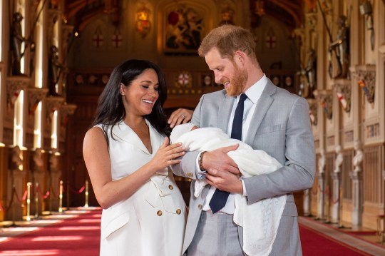 Prince Harry and Duchess Meghan of Sussex pose with their newborn son at Windsor Castle, May 8, 2019.