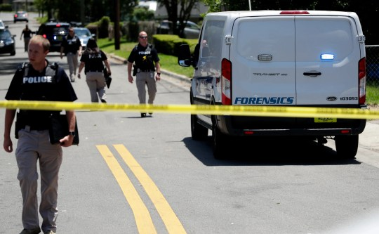 A forensic team and police officers present crime in the surrounding areas, where Gibbs Drive and Alice Jackson Lane close to Oakland Cemetery, Tuesday, May 14, 2019. intersect a victim.