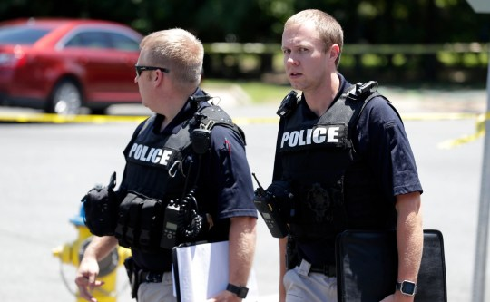 Two police officers leave a scene shot near Gibbs Drive and Alice Jackson Lane close to Oakland Cemetery Tuesday, May 14, 2019. The victim's death arose from the shooting.
