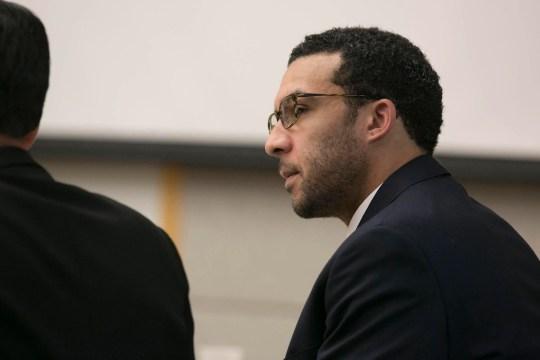 Kellen Winslow II looks at attorney Marc Carlos during his rape trial.