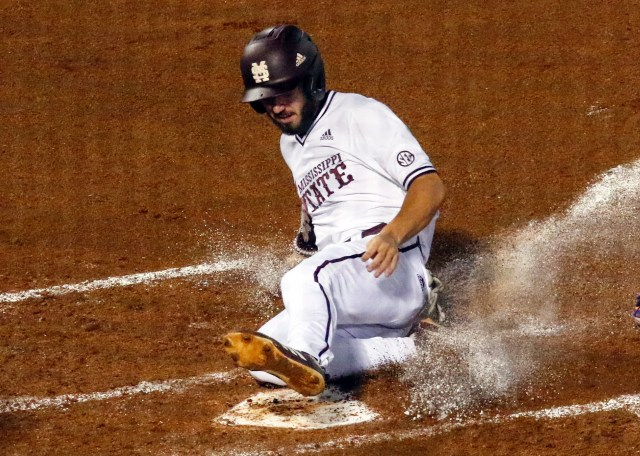 Mississippi State's Josh Hatcher scores during the second inning against LSU in an Southeastern Conference tournament NCAA college baseball game Wednesday, May 22, 2019, in Hoover, Ala. (AP Photo/Butch Dill)