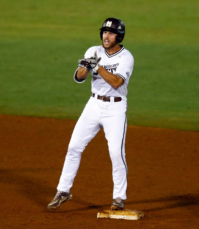 Mississippi State's Luke Hancock celebrates after hitting a double during the 10th inning of the Southeastern Conference tournament NCAA college baseball game against LSU, Thursday, May 23, 2019, in Hoover, Ala. (AP Photo/Butch Dill)