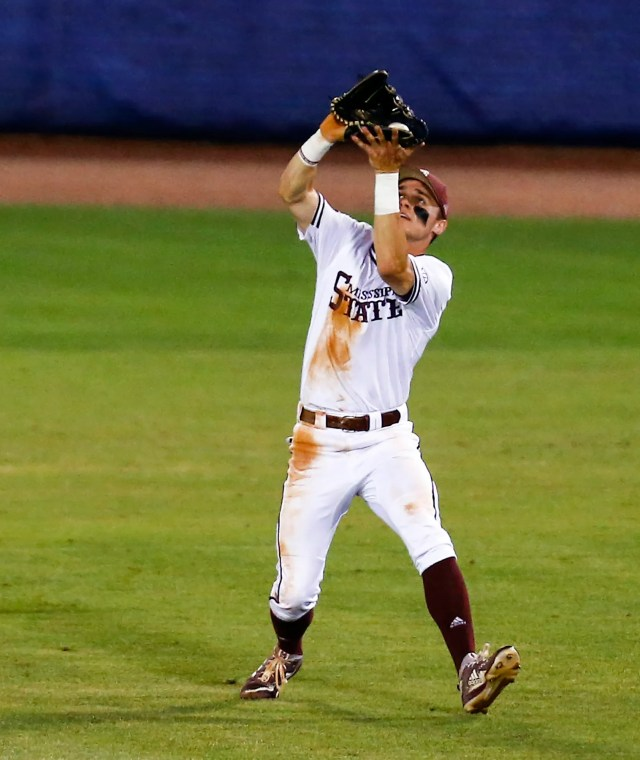 Mississippi State center fielder Jake Mangum catches a fly ball for the out on LSU's Brandt Broussard during the third inning of a Southeastern Conference tournament NCAA college baseball game Wednesday, May 22, 2019, in Hoover, Ala. (AP Photo/Butch Dill)