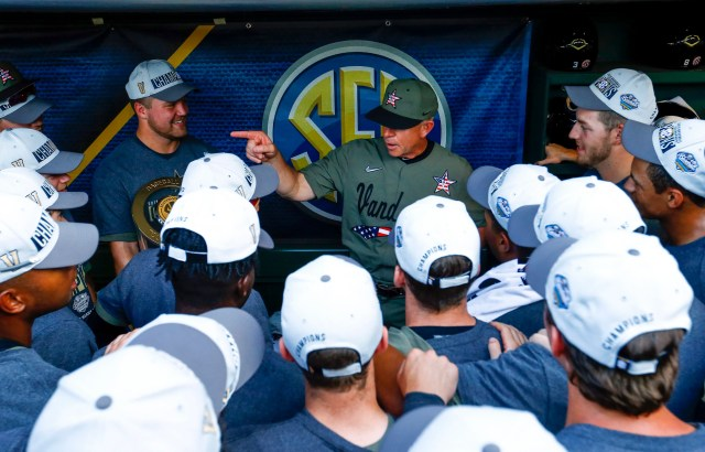 Vanderbilt coach Tim Corbin talks with players after defeating Mississippi to win the Southeastern Conference tournament NCAA college baseball championship game, Sunday, May 26, 2019, in Hoover, Ala. Vanderbilt won 11-10.