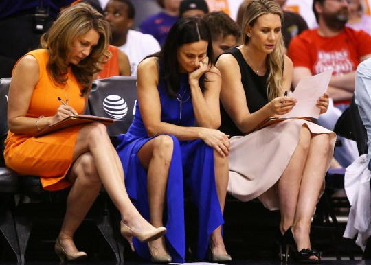 Phoenix Mercury coaches Julie Hairgrove, Sandy Brondello and Penny Taylor (right) study the stat sheet against Las Vegas Aces in the first half during the home opener on May 31, 2019 in Phoenix, Ariz.