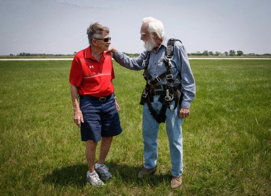 Ronald Mason, 100, of West Des Moines, right, talks with friend Dick Hanson after jumping out of an airplane on Saturday, June 1, 2019, at Des Moines Skydivers in Winterset.