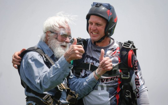 Ronald Mason, 100, of West Des Moines, gives two thumbs up after landing a tandem dive from 13,000 feet above earth with professional skydiver John Huddleson, right, on Saturday, June 2, 2019, at Des Moines Skydivers in Winterset. The jump fulfilled a lifelong dream for the centenarian, a World War 2 veteran who flew planes for the U.S. Navy.