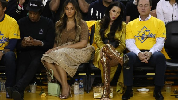 You may ask:Who is the woman who seemed to get a (literal) cold shoulder from Beyonce? Her name isNicole Curran,the wife of theGolden State Warriorsmajority owner JosephLacob.