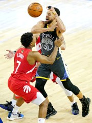 Warriors guard Stephen Curry loses the ball against Raptors guard Kyle Lowry during the third quarter in Game 4 of the NBA Finals at Oracle Arena.