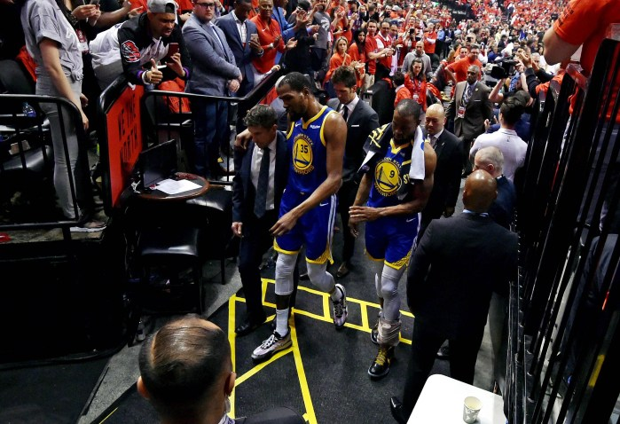 Kevin Durant heads to the locker room after injuring his right Achilles early in the second quarter.