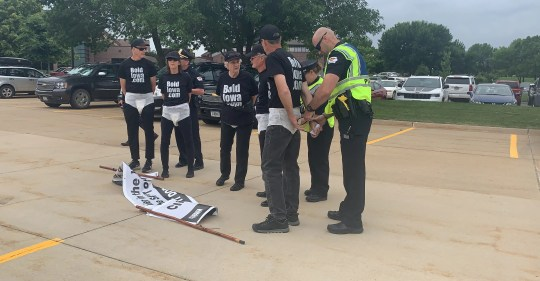 Five protesters with Bold Iowa are arrested while advocating for solutions for climate change on Tuesday, June 11, 2019 at Hy-Vee's corporate office. The quintet walked on the private property of the business and were cited for trespassing during a fundraising event  for President Donald Trump.