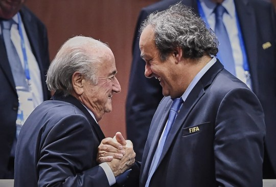 A file picture taken on May 29, 2015 shows FIFA President Sepp Blatter (left) shakes hands with UEFA president Michel Platini after being re-elected following a vote to decide on the FIFA presidency in Zurich.
