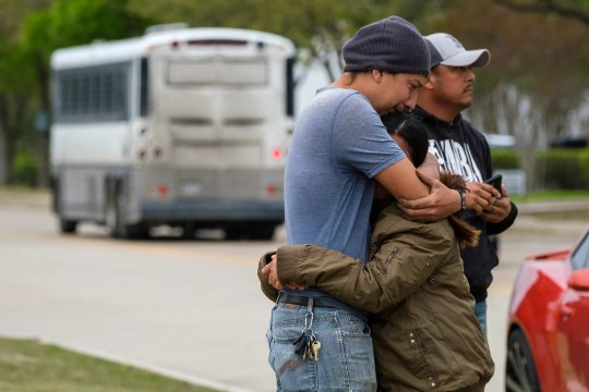 In this April 3, 2019, photo file, a couple who gave their names to the outside CVE Group as a bus from LaSalle Corrections Transport departs the facility in McAllen, Texas. Immigrant families and advocates are warning about planned arrests around the country by the Immigration and Customs Enforcement Agency.