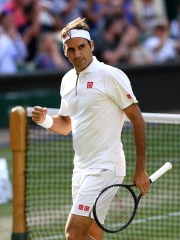 Roger Federer of Switzerland reacts in his Men's Singles semi-final match against Rafael Nadal of Spain during Day eleven of The Championships - Wimbledon 2019 at All England Lawn Tennis and Croquet Club on July 12, 2019 in London, England.