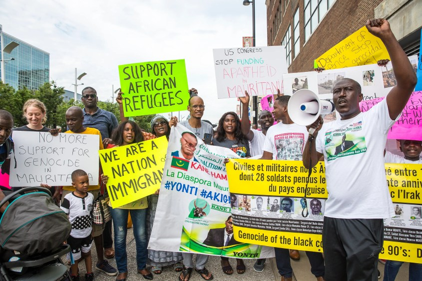"Ibrahima Guisset chants ""What do we want?"" The crowd yells, ""Justice."" Members of the Mauritanian-American community and supporters march Monday through Downtown to protest what they say are human rights violations against Afro-Mauritanians in the northwest African nation."