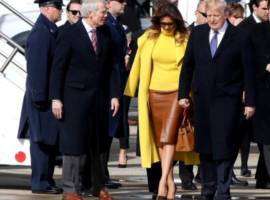 Senator Rob Portman, left, First Lady Melania Trump and President Donal at Lunken Airport Monday February 5, 2018.
