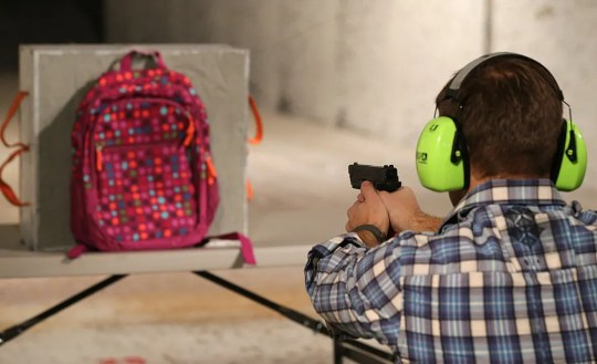 Chief Operating Officer for Amendment II, Rich Brand, shoots a child's backpack with their Rynohide CNT Shield in it in Salt Lake City, Utah.