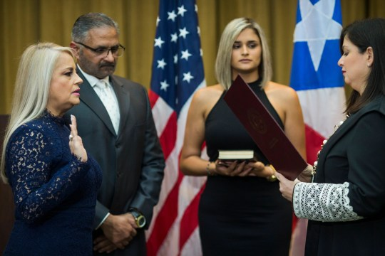 Justice Secretary Wanda Vazquez is sworn in as governor of Puerto Rico by Supreme Court Justice Maite Oronoz, in San Juan, Puerto Rico on Aug. 7, 2019.