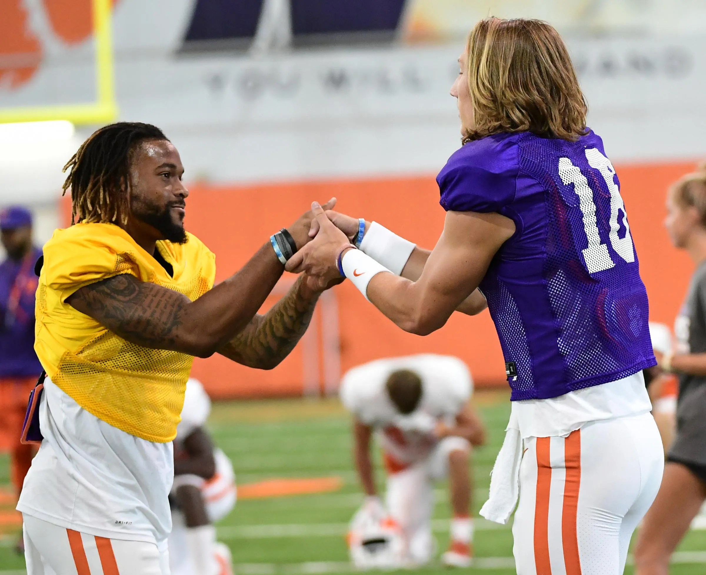 Clemson wide receiver Amari Rodgers (3) greets quarterback Trevor Lawrence (16) during practice at the Poe Indoor Facility in Clemson on Tuesday August 20, 2019.
