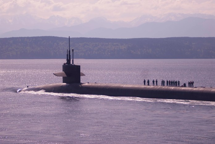 The Ohio-class ballistic missile submarine USS Louisiana transits the Hood Canal off the Olympic Peninsula in Washington in 2018. Edward Fix was stationed on the ship in 2001 when he was involved in the racially motivated beating of a Black man in Jacksonville, Florida.