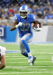 Kerryon Johnson of the Detroit Lions runs the ball during the first half against the Buffalo Bills on Friday, August 23, 2019 at Ford Field.