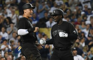 In a matchup of powerhouse clubs, the Yankees blast their way to a win against the Dodgers