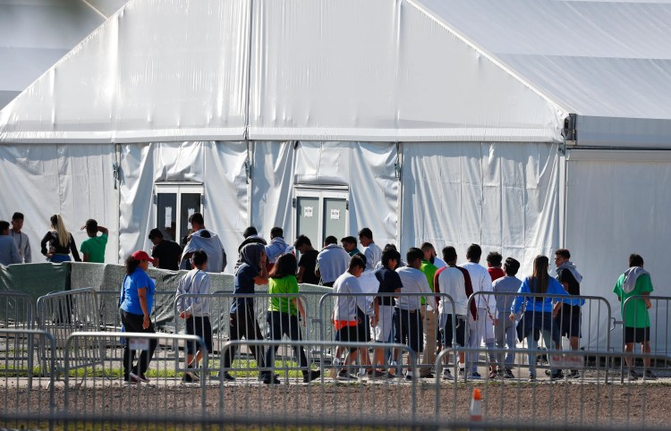 Children line up to enter the Homestead Temporary Shelter for Unaccompanied Children in Homestead, Fla., in February 2019.