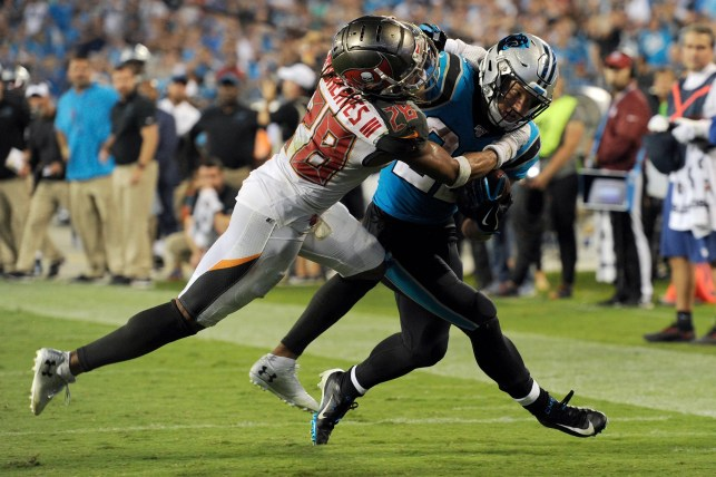 Buccaneers use late goal-line stand to hold off Panthers for first win