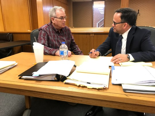 Defendant Robert Dean Penny (left) consults with attorney Sam Pasthing prior to the resumption of court proceedings of Penny's first-degree murder trial in Mountain Home.