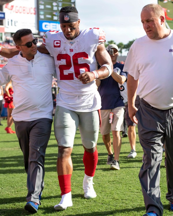 Giants RB Saquon Barkley in walking boot, using crutches after injury