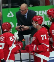 Detroit Red Wings head coach Jeff Blashill talks to players as Dylan Larkin (71) listens during action against the Dallas Stars on Sunday October 6, 2019 at Little Caesars Arena.