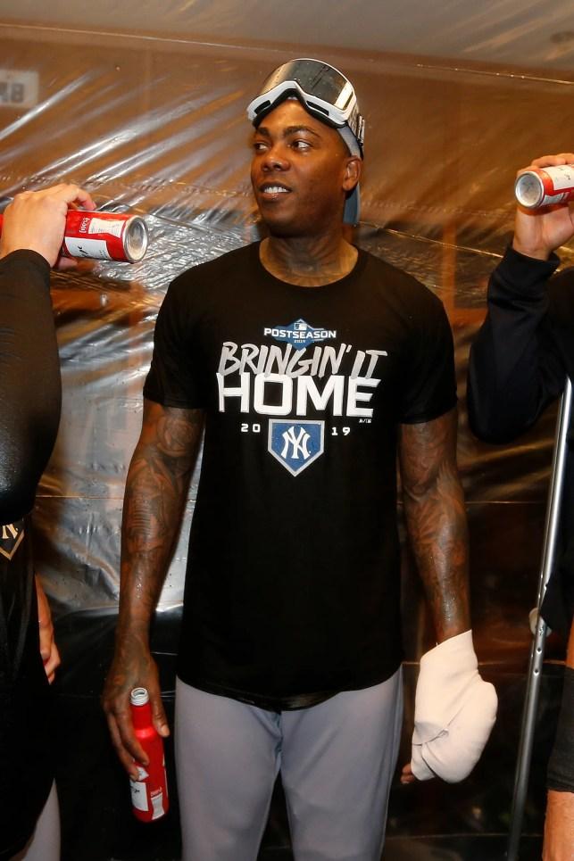 Yankees closer Aroldis Chapman has pitching hand injured by bottle during celebration