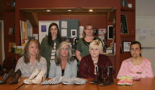 The women of Serenity Domestic Violence Support and Shelter include: (front row, from left) Sherry Tittle, Shelter Manager; Donna Forrester, Shelter Director; Windy Grieve, Child Advocate; Melinda Fulton, Program Outreach Coordinator; Iretha Orrick, In-shelter case manager; Leslie Rouse, Officer Manager. Not pictured: Karen Rose, outreach case manager.