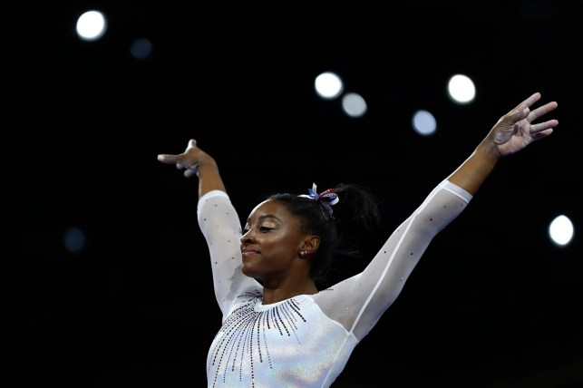 Opinion: Simone Biles makes more history, wins fifth all-around title at worlds