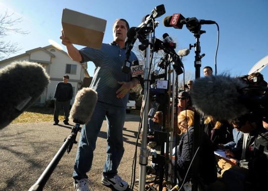 Richard Heene directs media representatives to place their questions in a cardboard box so he could review them and respond during an evening press conference he called for outside his southeast Fort Collins home, pictured in the background, Oct. 17, 2009.