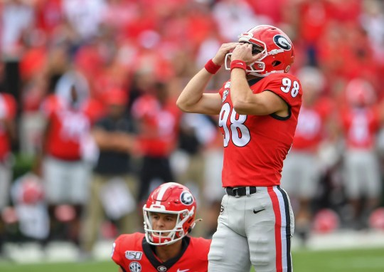 Georgia place kicker Rodrigo Blankenship (98) reacts after missing a field goal in the second overtime against South Carolina.