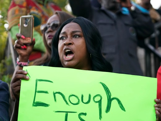 """Carol Harrison-Lafayette protests the police shooting of Atatiana Jefferson during a community vigil for Jefferson on on Oct. 13, 2019, in Fort Worth, Texas. A white police officer who killed the black woman inside her Texas home while responding to a neighbor's call about an open front door """"didn't have time to perceive a threat"""" before he opened fire, an attorney for Jefferson's family said."""