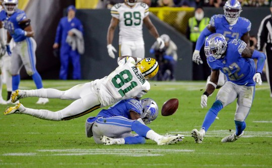 Lions safety Tracy Walker, bottom, breaks up a pass intended for Packers receiver Geronimo Allison during the third quarter Monday.