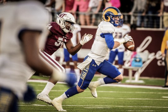 Angelo State University's Quarterback Payne Sullins fought for yardage during the Lone Star Conference match against West Texas A&M at Buffalo Stadium in Canyon, Saturday, October 20, 2019.