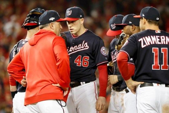 Nationals pitcher Patrick Corbin has a meeting on the mound during Game 4 of the NLCS.