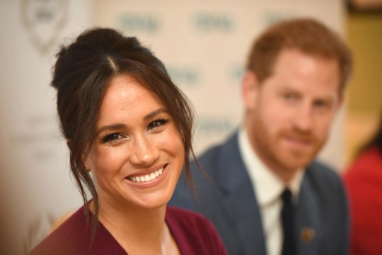 Duchess Meghan of Sussex and Prince Harry attend a roundtable discussion on gender equality at Windsor Castle on Oct. 25, 2019.