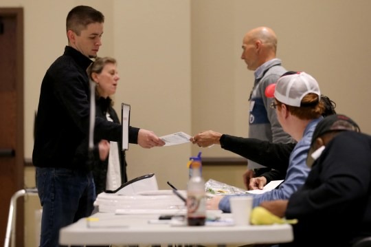 Poll workers distributed ballots to voters on Tuesday, November 5, 2019, at the Knox Presbyterian Church in Hyde Park.